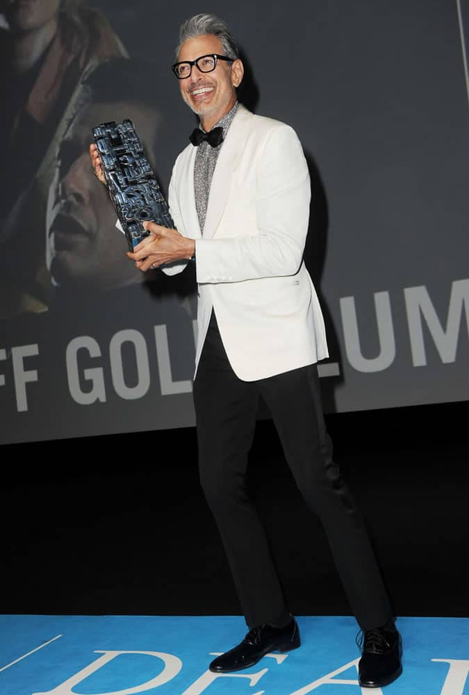 Jeff Goldblum pictured in a white dinner jacket at the Paris premiere of Kidnap