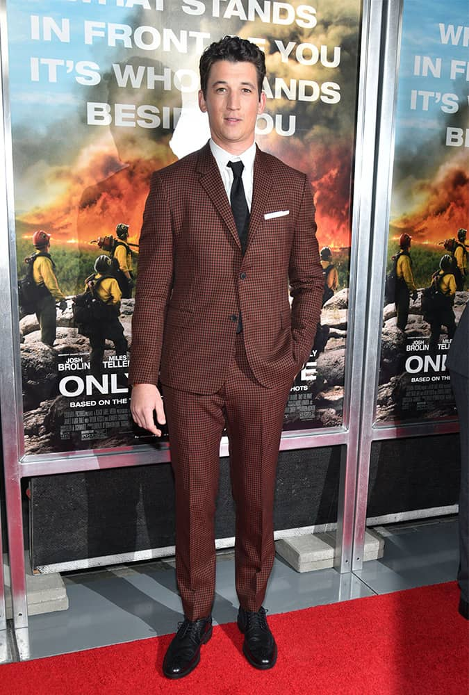 Miles Teller wearing a rust-coloured suit