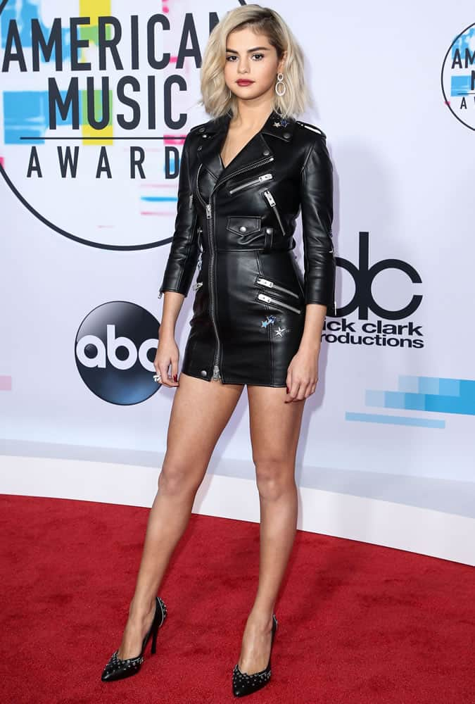 Selena Gomez With Blonde Hair Wearing A Leather Dress