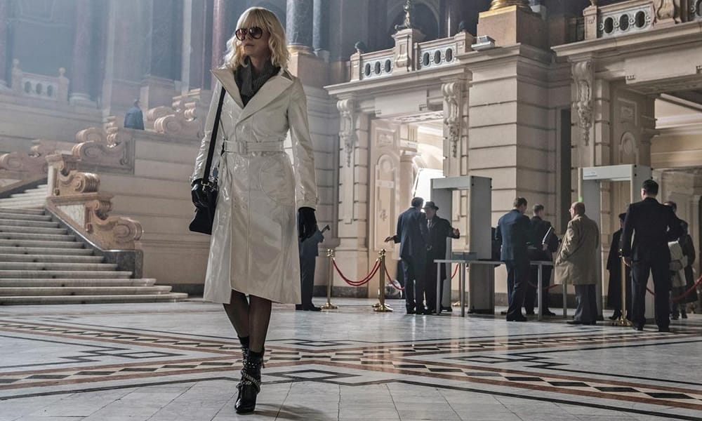 Charlize Theron Wearing A White Coat In Atomic Blonde