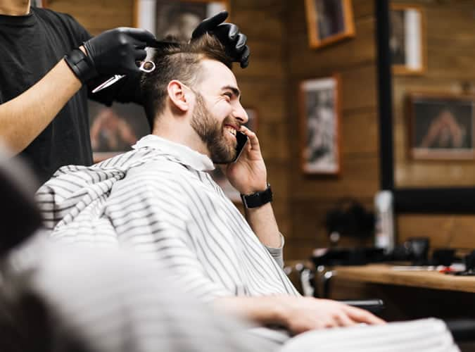 During your haircut, don't use your mobile phone