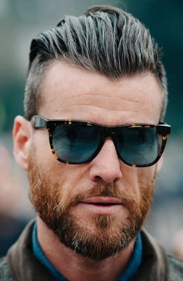 A high slick back pompadour with the sides taken tight