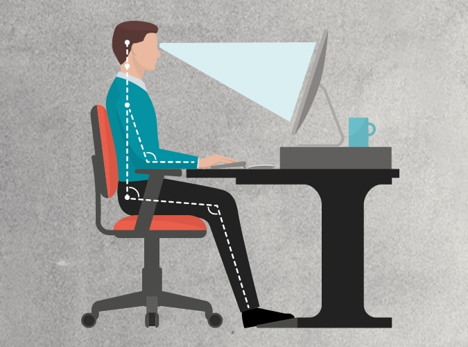 Good posture for a man sitting down in front of monitor