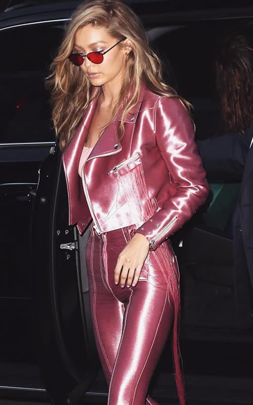 Gigi Hadid wearing a pink leather suit