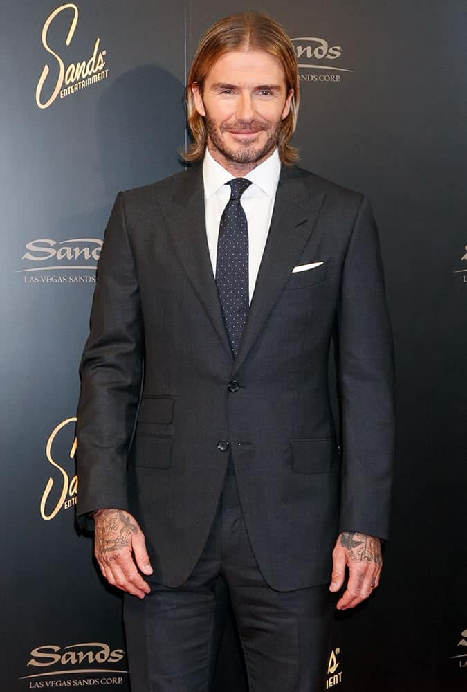 David Beckham with long hair wearing a suit